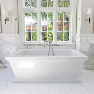 Example of a classic subway tile freestanding bathtub design in San Francisco with a pedestal sink
