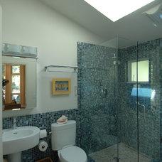 Tropical Bathroom by Nunley Custom Homes