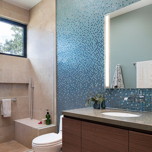 Mid-sized contemporary kids bathroom in San Francisco with flat-panel cabinets, dark wood cabinets, an alcove shower, a one-piece toilet, blue tile, glass tile, limestone floors, an undermount sink, engineered quartz benchtops, beige floor and brown benchtops.