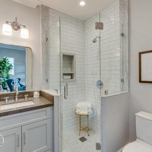 ロサンゼルスの小さいトランジショナルスタイルのバスルーム (浴槽なし)の画像 (落し込みパネル扉のキャビネット、白いキャビネット、アルコーブ型シャワー、白いタイル、白い壁、アンダーカウンター洗面器、開き戸のシャワー、ブラウンの洗面カウンター)