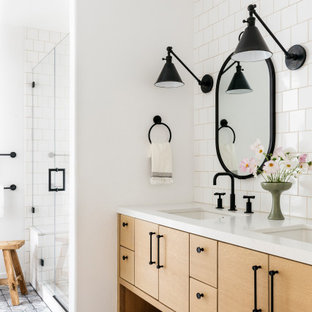 Photo of a mid-sized country kids bathroom in San Francisco with beaded inset cabinets, light wood cabinets, an alcove shower, a two-piece toilet, white tile, ceramic tile, white walls, terra-cotta floors, an undermount sink, engineered quartz benchtops, blue floor, a hinged shower door, white benchtops, an enclosed toilet, a double vanity and a built-in vanity.