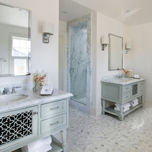 Inspiration for a large contemporary master bathroom in San Francisco with an undermount sink, furniture-like cabinets, an alcove shower, white walls, marble floors, white floor, a hinged shower door, grey cabinets, a freestanding tub and marble benchtops.