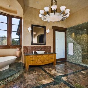 Freestanding bathtub - rustic mosaic tile freestanding bathtub idea in Austin with a vessel sink