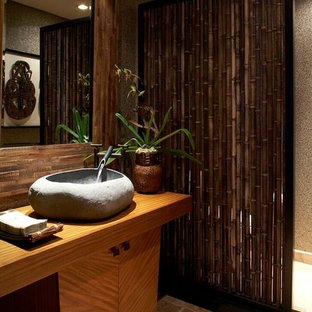 Example of an island style bathroom design in Hawaii with a vessel sink