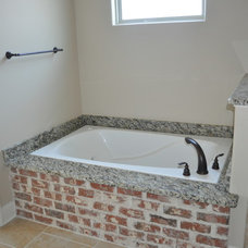 Traditional Bathroom by Crescent Land Development LLC