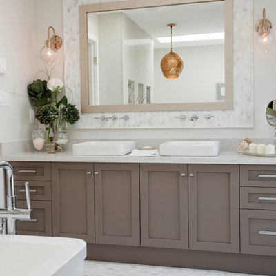 Freestanding bathtub - transitional freestanding bathtub idea in Vancouver with white countertops