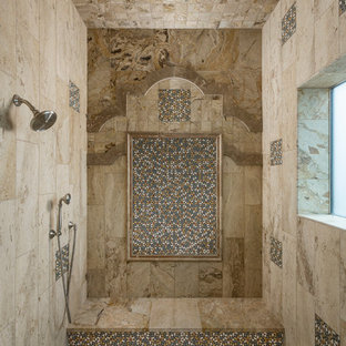 This is an example of a large mediterranean ensuite bathroom in Phoenix with an alcove shower, beige tiles, stone tiles and travertine flooring.