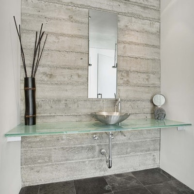 Inspiration for a contemporary black floor bathroom remodel in San Francisco with a vessel sink and turquoise countertops