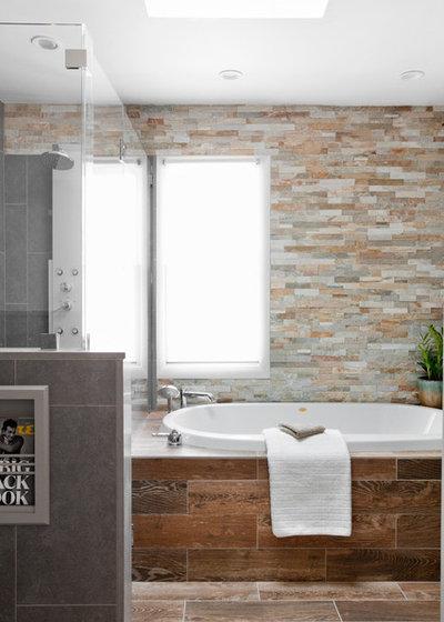 De la pierre naturelle dans la salle de bains bonne ou - Salle de bain avec mur en pierre ...
