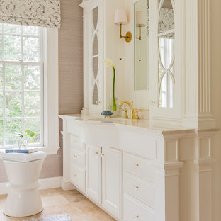 Inspiration for a transitional beige floor bathroom remodel in Boston with raised-panel cabinets, white cabinets, gray walls, an undermount sink and white countertops
