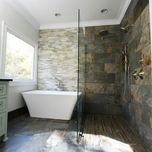 This is an example of a large modern master bathroom in Atlanta with furniture-like cabinets, grey cabinets, a freestanding tub, an open shower, beige tile, brown tile, gray tile, slate, grey walls, slate floors, multi-coloured floor and an open shower.