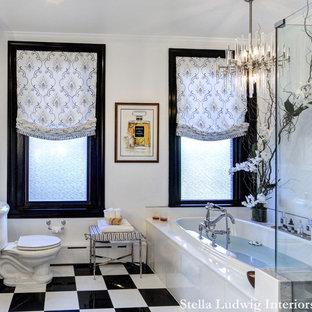 Esempio di una stanza da bagno padronale design di medie dimensioni con consolle stile comò, vasca idromassaggio, doccia ad angolo, WC monopezzo, piastrelle di marmo, pareti bianche, pavimento in marmo, lavabo a bacinella, top in marmo, pavimento nero e porta doccia a battente