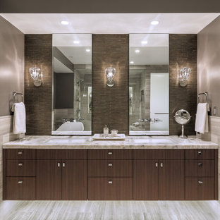 Inspiration for a mid-sized contemporary master gray tile and stone tile gray floor bathroom remodel in Seattle with flat-panel cabinets, dark wood cabinets, onyx countertops and gray countertops