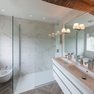 Luxurious bathroom with marble tiled walls and herringbone pattern