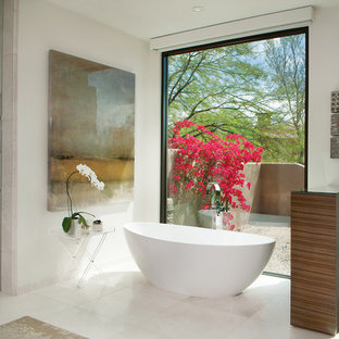 Large trendy master white tile and marble tile marble floor and white floor bathroom photo in Phoenix with white walls, a vessel sink, flat-panel cabinets, medium tone wood cabinets, a one-piece toilet and engineered quartz countertops