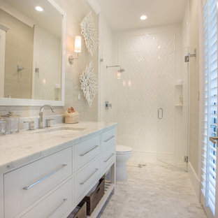 Mid-sized transitional white tile walk-in shower photo in Miami with an undermount sink, flat-panel cabinets, white cabinets and marble countertops