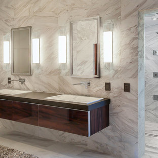 Huge minimalist master gray tile and marble tile marble floor and gray floor bathroom photo in Houston with furniture-like cabinets, dark wood cabinets, a two-piece toilet, gray walls, an undermount sink, quartzite countertops and gray countertops