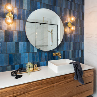Contemporary master bathroom in Geelong with engineered quartz benchtops, white benchtops, flat-panel cabinets, medium wood cabinets, an alcove shower, blue tile and a vessel sink.