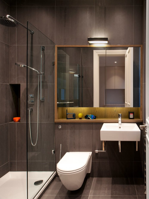 inspiration for a small contemporary 34 brown tile and stone tile corner shower remodel