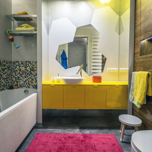 Mid-sized eclectic kids' ceramic tile and multicolored tile porcelain floor and gray floor bathroom photo in Other with yellow cabinets, yellow countertops, flat-panel cabinets, a wall-mount toilet, multicolored walls and a vessel sink