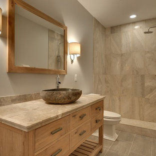 Example of a mid-sized transitional 3/4 gray tile and stone tile ceramic tile bathroom design in Minneapolis with a vessel sink, furniture-like cabinets, light wood cabinets, tile countertops, a two-piece toilet and gray walls