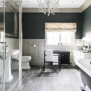 Bathroom - large traditional white tile and ceramic tile bathroom idea in Other with furniture-like cabinets, a one-piece toilet, gray walls, a pedestal sink, marble countertops and a hinged shower door