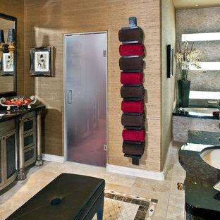 Réalisation d'une salle de bain principale sud-ouest américain de taille moyenne avec un placard avec porte à panneau encastré, des portes de placard en bois vieilli, une baignoire encastrée, un espace douche bain, un carrelage beige, des carreaux de porcelaine, un mur beige, un sol en carrelage de porcelaine, un lavabo encastré, un plan de toilette en granite, un sol beige et une cabine de douche à porte battante.
