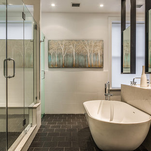 Trendy master black floor bathroom photo in New York with white walls, an undermount sink, a hinged shower door and gray countertops