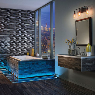 Inspiration for a large contemporary master bathroom in Chicago with a drop-in tub, multi-coloured tile, mosaic tile, grey walls, dark hardwood floors, an undermount sink and zinc benchtops.