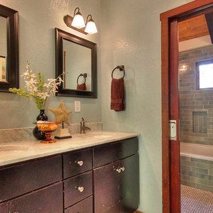Inspiration for a mid-sized craftsman 3/4 corner bathtub remodel in San Francisco with flat-panel cabinets, brown cabinets, multicolored walls, an undermount sink and granite countertops