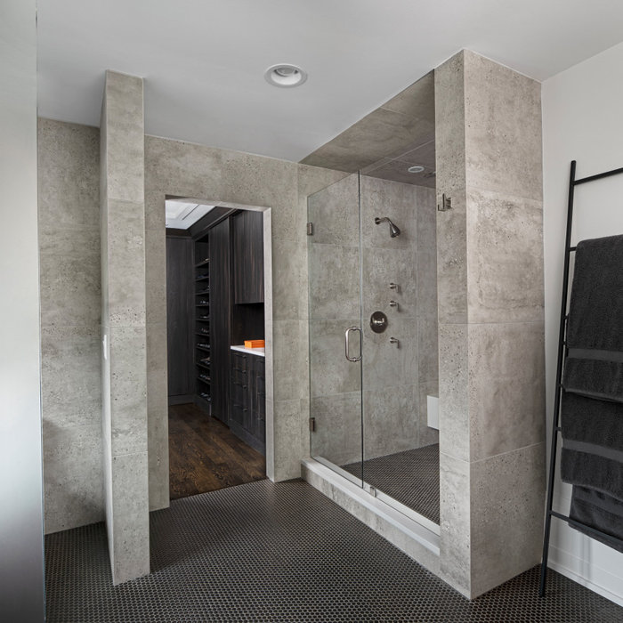 A steam shower and heated floor give our Men's bathroom the proper start to each day. With sleek porcelain tile walls and a copper penny round floor, we have found a soothing balance between strong an