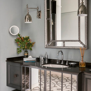 Photo of a traditional bathroom in London with recessed-panel cabinets, grey cabinets, grey walls, a submerged sink, grey floors and brown worktops.
