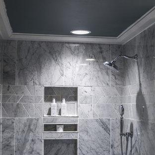 Esempio di una stanza da bagno stile rurale con bidè, piastrelle in pietra e pavimento in marmo