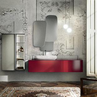 Aménagement d'une grand salle de bain principale moderne avec une vasque, un placard en trompe-l'oeil, des portes de placard rouges, un plan de toilette en surface solide, une douche d'angle et béton au sol.
