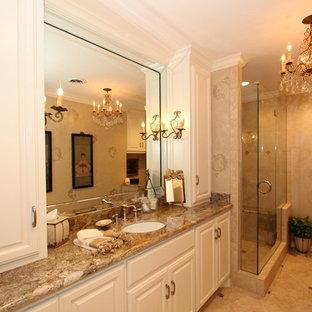 Exemple d'une petit salle de bain principale chic avec un placard avec porte à panneau encastré, des portes de placard blanches, une douche d'angle, un carrelage beige, des carreaux de céramique, un mur multicolore, un sol en carrelage de céramique, un lavabo encastré, un plan de toilette en granite, un sol beige et une cabine de douche à porte battante.