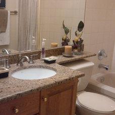 Traditional Bathroom by Artisan Stone Furnishings Ltd