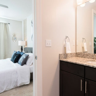 Inspiration for a mid-sized eclectic 3/4 gray tile and ceramic tile light wood floor and gray floor bathroom remodel in Orlando with shaker cabinets, dark wood cabinets, a one-piece toilet, gray walls, an undermount sink and granite countertops