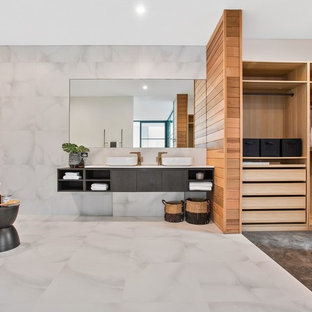 This is an example of a contemporary master bathroom in Perth with flat-panel cabinets, grey cabinets, a freestanding tub, gray tile, white tile, grey walls, a vessel sink, white floor and white benchtops.