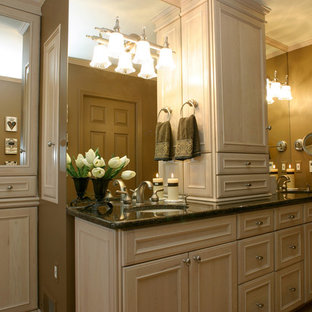 Bathroom - traditional bathroom idea in Detroit with an undermount sink, recessed-panel cabinets and light wood cabinets