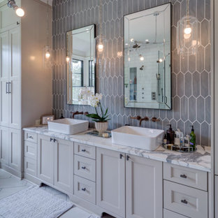 Inspiration for a large transitional master bathroom in Atlanta with shaker cabinets, grey cabinets, ceramic tile, porcelain floors, a vessel sink, marble benchtops, white floor, multi-coloured benchtops, a double vanity, a built-in vanity and gray tile.