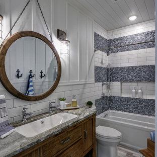 Стильный дизайн: детская ванная комната среднего размера в морском стиле с фасадами островного типа, искусственно-состаренными фасадами, ванной в нише, душем над ванной, унитазом-моноблоком, белой плиткой, цементной плиткой, белыми стенами, полом из цементной плитки, врезной раковиной, столешницей из гранита, разноцветным полом, шторкой для душа, разноцветной столешницей, тумбой под одну раковину, напольной тумбой, потолком из вагонки и панелями на стенах - последний тренд