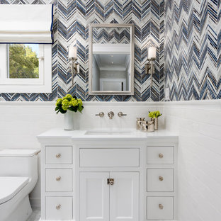 Small elegant 3/4 glass tile marble floor bathroom photo in Los Angeles with recessed-panel cabinets, white cabinets, a one-piece toilet, blue walls, an undermount sink and quartz countertops