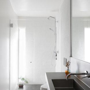Foto di una stanza da bagno minimalista con top in acciaio inossidabile