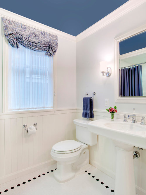 Example of a classic white tile bathroom design in Seattle with a pedestal  sink and a