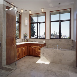 Example of a trendy beige tile alcove bathtub design in Seattle with shaker cabinets and medium tone wood cabinets