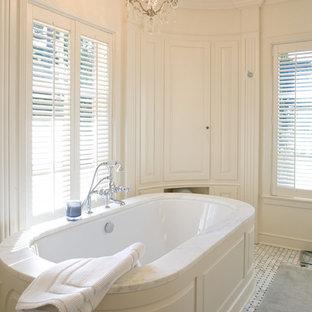 Bathroom - contemporary bathroom idea in Seattle with an undermount tub