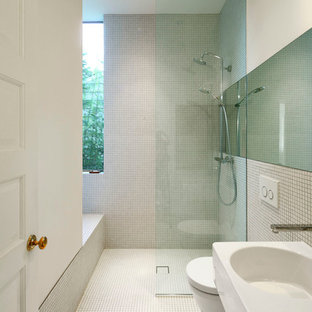 Mid-sized trendy 3/4 white tile and mosaic tile mosaic tile floor and white floor bathroom photo in Seattle with a wall-mount sink, a wall-mount toilet and white walls