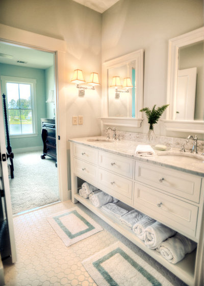 Cute Traditional Bathroom by Shoreline Construction and Development