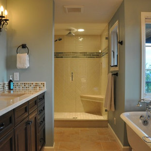 Bathroom - large transitional master multicolored tile and ceramic tile porcelain floor bathroom idea in Seattle with an undermount sink, recessed-panel cabinets, dark wood cabinets, marble countertops, a two-piece toilet and blue walls