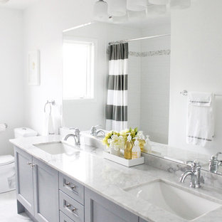 Bathroom - traditional bathroom idea in Toronto with marble countertops, an undermount sink and gray cabinets